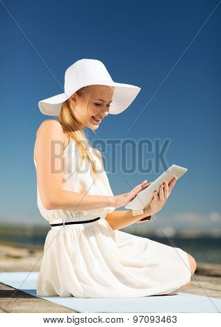 beauty, lifestyle and internet - young woman with tablet pc