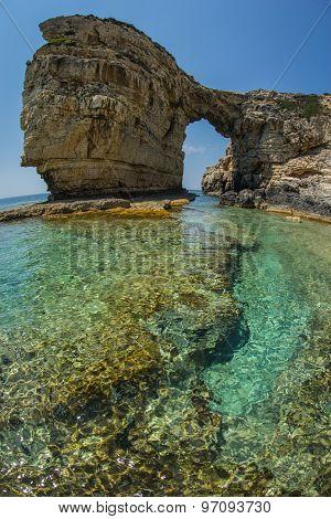 Unique And Scenic Arch In The Cliffs, Paxi, Greece
