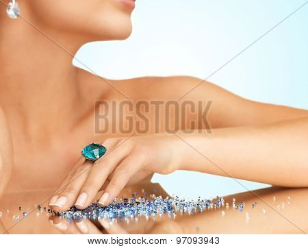 woman's hand with cocktail ring on the mirror
