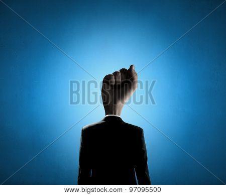 Headless businessman with fist instead of head