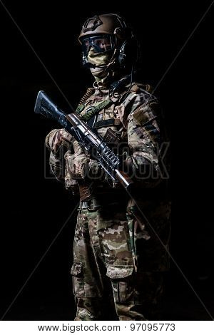 Special Forces Soldier In Camouflage With Rifle