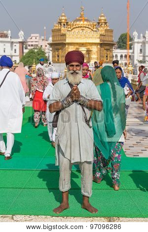 Sikh Man And Indian People Visiting The Golden Temple In Amritsar, Punjab, India.