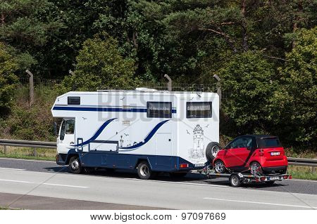 Mobile Home With A Car On Trailer