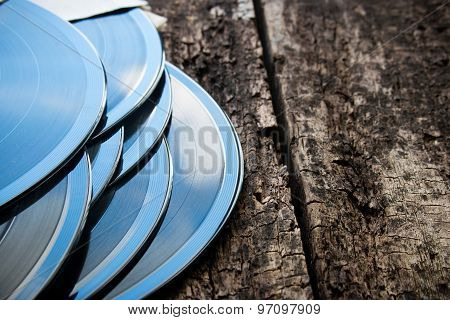 Stack Of Vinyl Records On A Wooden Background