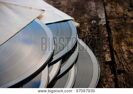 Stack Of Vinyl Records On A Wooden Background Closeup
