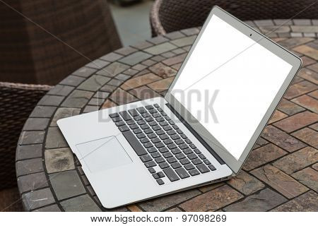Blank screen laptop computer on table