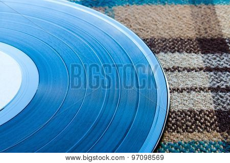 Vinyl Record On A Plaid
