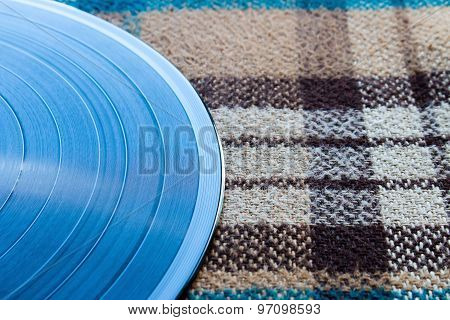 Vinyl Record On A Plaid Closeup