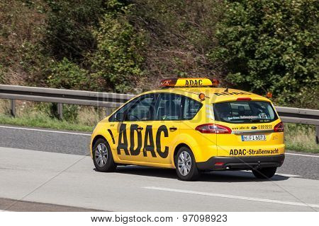 Yellow Adac Ford S-max On The Highway