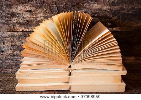 Lying On Each Other On Top Of Old Books Open Book With The Pages Fanned Out