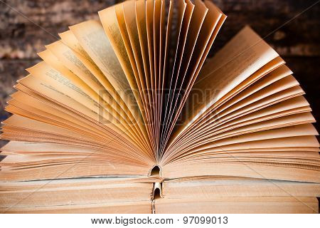Old Open Book Lying On The Other With A Fan And Pages