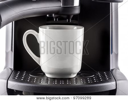 Closeup of modern coffee machine with white mug