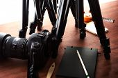 Tripods and DSLR camera. Ready for filming or photo session. Photography equipment.  poster