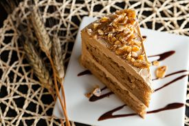image of icing  - Slice of almond toffee cake with coffee flavored icing - JPG