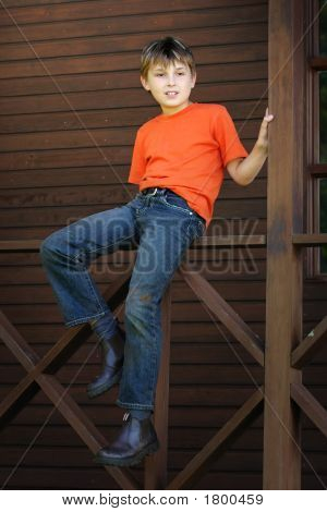 Boy Sitting On The Verandah
