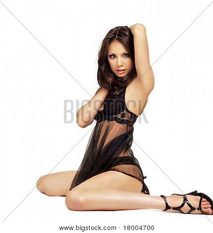 Beautiful young woman wearing black lingerie