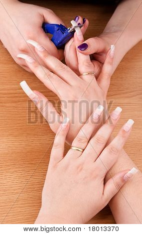 Manicurist Trimming Nail