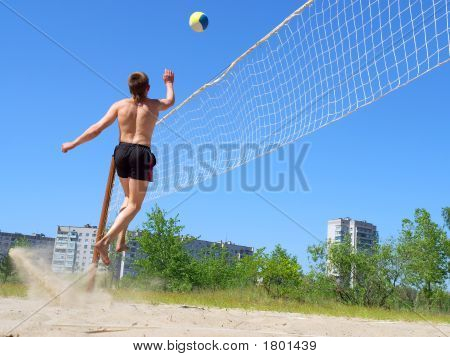 Playing Beach Volleyball - Teen Jumps High After Ball