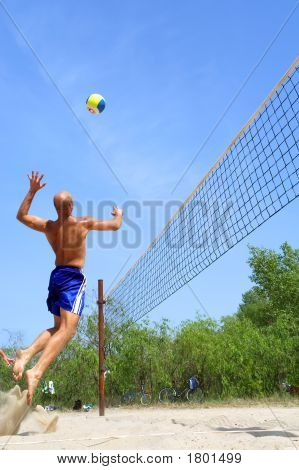 People Playing Beach Volleyball - Balding Strong Man Spikes