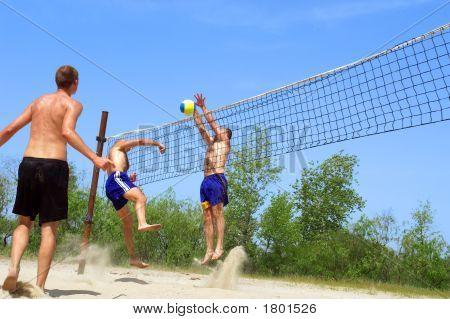 Three Men Playing Beach Volleyball - Fight Near Net