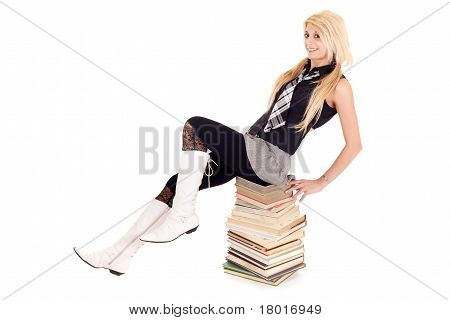 Schoolgirl Sitting On Books