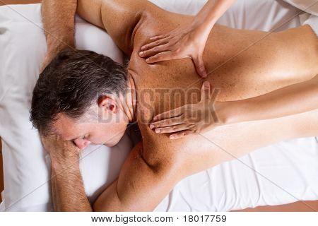middle aged man having back massage