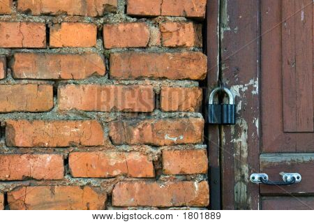 Old Wall And Door With The Lock
