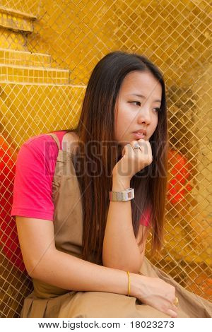 Young Thai Women Distracted And Rest Her Chin On Hand