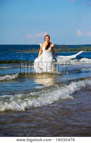 Bride Running In Waves