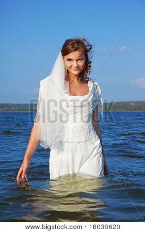 Bride Walking In Waves