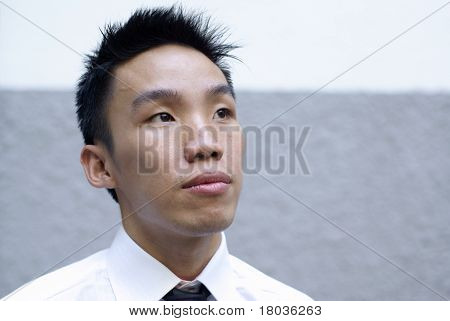 Aspiring asian male executive looking up
