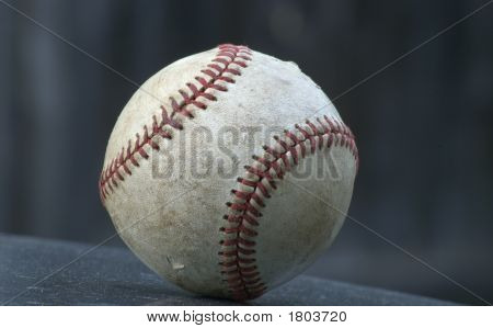 Old Isolated Baseball Against A Dark Background
