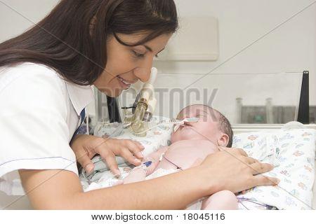 Beautiful Nurse And Newborn