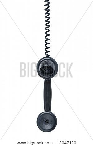 Old vintage phone with wear and tear hanging off the hook