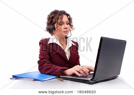 Woman with headset and laptop