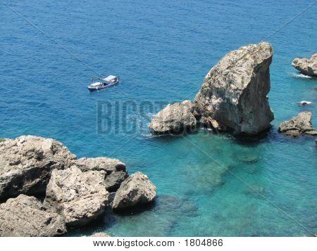 Boat At Rocks