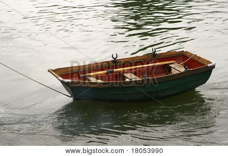 A boat being towed away on the river