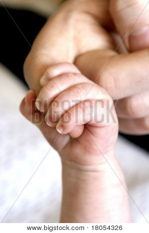 I'll be there for you : Tiny baby's fingers grasping tight onto the mother's index finger