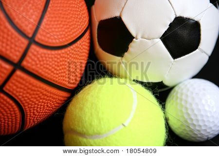 One shape, different colours and designs. A basketball, a football, a tennisball and a golfball