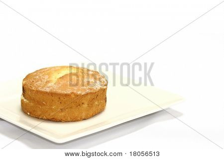 A victoria sponge cake served on a plate, isolated on white with copy space