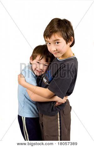Conceptual image of two beautiful brothers of mix parentage giving each other a brotherly hug.