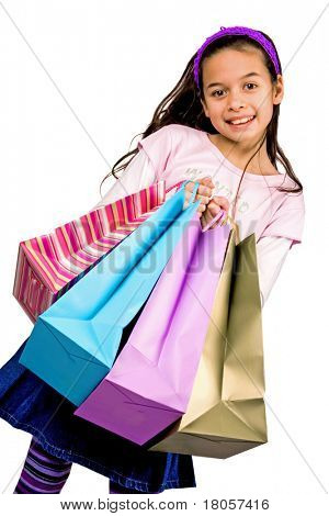 A young girl of mix parentage shows off her shopping, isolated on white.