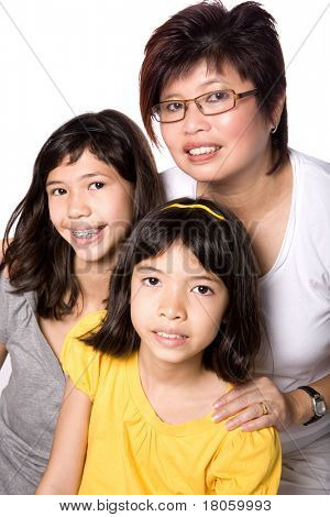 Happy Chinese mom with her two beautiful daughters of mix parentage.