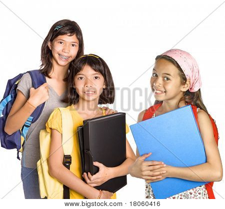 Three young girl students with books, folders and rucksack for school.