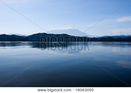 View of Mount Kinabalu in the far horizon seen from the inland lake in Sabah
