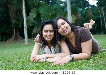 Beautiful Asian mother and daughter enjoying the summer park