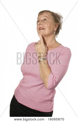Beautiful caucasian female senior in pink top in thinking gesture