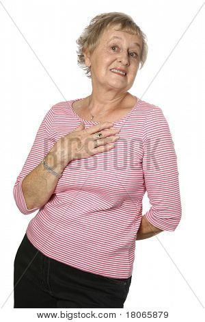 Beautiful caucasian female senior in pink top with hand on chest