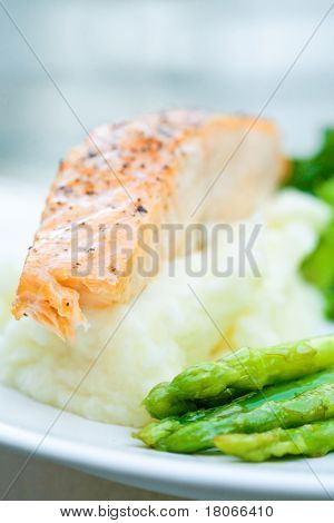 Baked salmon with mash potato and grilled asparagus