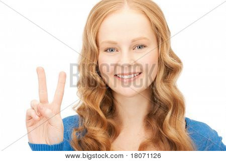 bright picture of lovely teenage girl showing victory sign